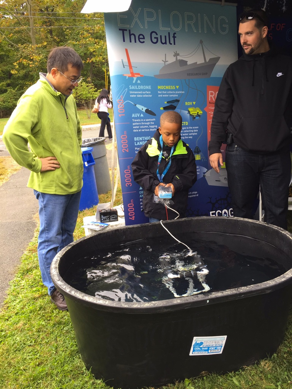 <div style='color:#000000;'><br /><br /><h2>Dr. Beizhan Yan talking with a couple of visitors to the Ocean Discovery Zone at Lamont-Doherty Earth Observatory's 2016 annual open house</h2>Photo courtesy of Kyle Frischkorn</div>