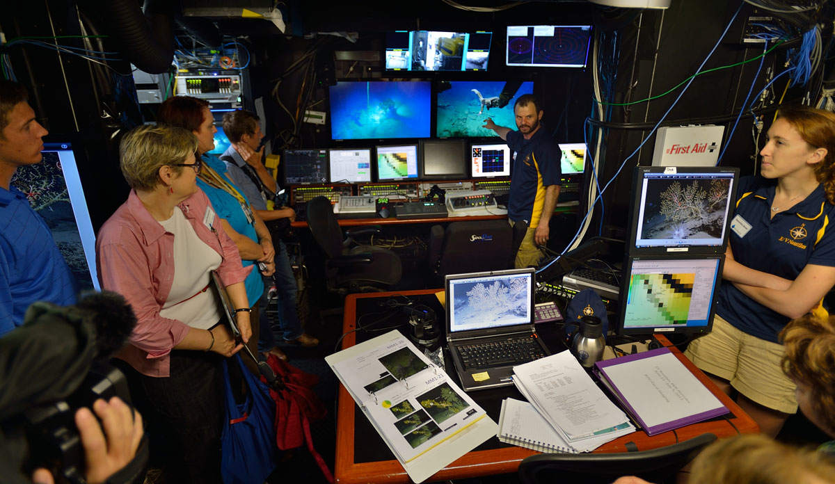 <div style='color:#000000;'><br /><br /><h2>Dr. Erik Cordes (ECOGIG) inside the ROV (remotely operated vehicle) control room on board the E/V Nautilus. The screens display the  camera feeds from ROV Hercules and ROV Argus.</h2>Photo courtesy of Ocean Exploration Trust</div>